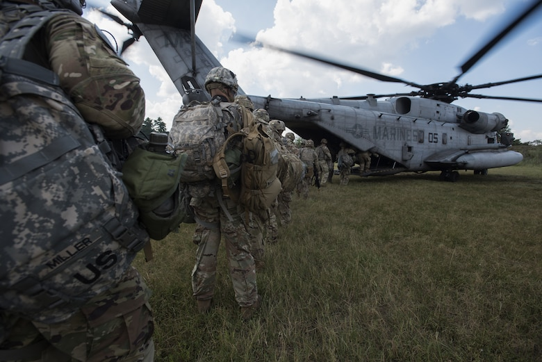 Soldiers with the 101st Airborne Division board a Marine Heavy Helicopter Squadron 772 (HMH-772) CH-53E Super Stallion during a training exercise near Joint Base McGuire-Dix-Lakehurst, New Jersey, Sept. 6, 2018. Marines with HMH-772 made 10 trips from one point to another, transporting Soldiers for reconnaissance missions. (U.S. Air Force photo by Airman Ariel Owings)