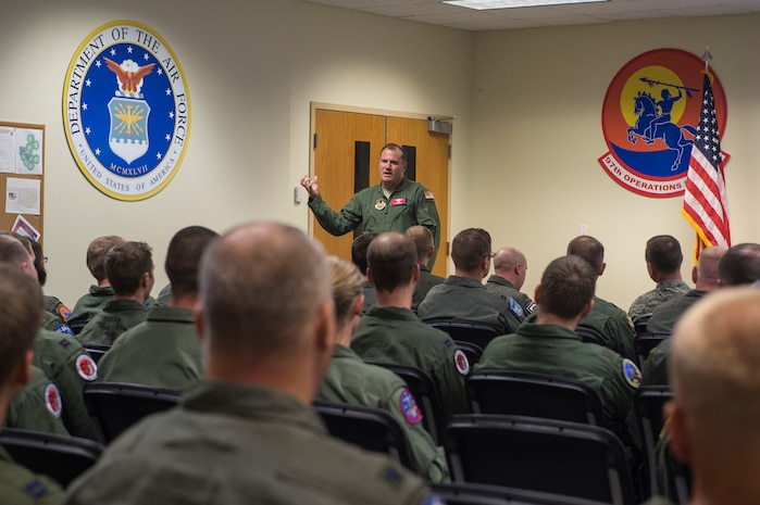 U.S. Air Force Brig. Gen. Kenneth T. Bibb Jr., director of Air, Space and Cyberspace Operations at Headquarters Air Force Materiel Command at Wright-Patterson Air Force Base, Ohio, talks to members of the 97th Air Mobility Wing about his perspective on current Mobility Air Force operations, Sept. 21, 2018, at Altus Air Force Base, Okla. Bibb is currently here for the senior officer training course and wanted to use his time here to share some knowledge with the instructors of the 97th AMW. (U.S. Air Force photo by Senior Airman Cody Dowell)