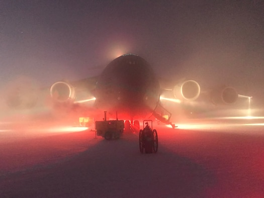 A C-17 Globmaster III sits on the runway at McMurdo Station in Antarctic. At the request of the National Science Foundation, aircrews from the 304th Expeditionary Air Squadron supported an emergency medical evacuation of two patients Aug. 25. (Courtesy photo)