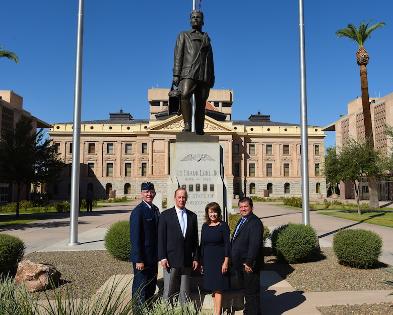 From left, Brig. Gen. Todd Canterbury, 56th Fighter Wing commander, Donald Luke, nephew of Lt Frank Luke Jr., Sen. Sine Kerr, Arizona State Senator and Rep. Tim Dunn Arizona House of Representatives pose for a photo in front of a statue representing Lt. Frank Luke Jr. Sept. 26, 2018 in Phoenix.
