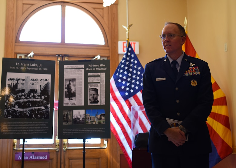 Brig. Gen. Todd Canterbury, 56th Fighter Wing commander, listens to a curator at the Arizona Capitol Museum after a ceremony for the 100th Anniversary of the death of Lt. Frank Luke Jr. Sept. 26, 2018 in Phoenix.