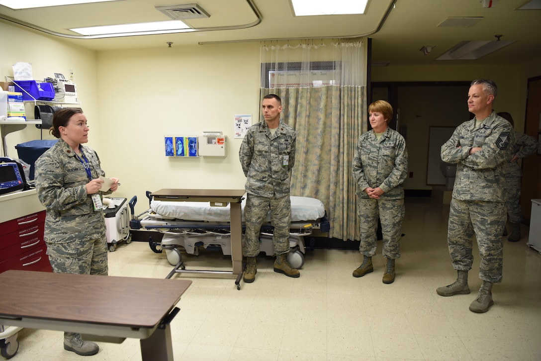 U.S. Air Force Maj. Michelle Buehner, left, 51st Medical Operation Squadron general surgeon, and U.S. Air Force Maj. Douglas Savey, center, 51st Medical Operation Squadron certified registered nurse anesthetist, brief U.S. Air Force Lt. Gen. Dorothy Hogg, Air Force Surgeon General, and U.S. Air Force Chief Master Sgt. Steven Cum, Medical Enlisted Force and Enlisted Corps chief, about the functions of the operating room at Osan Air Base, Republic of Korea, Sept. 24, 2018.