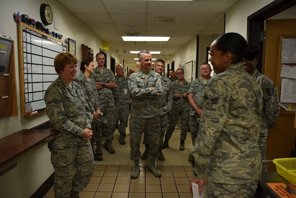 U.S. Air Force Senior Airman Lauren Eady, far right, 51st Medical Operation Squadron emergency medical technician, briefs U.S. Air Force Lt. Gen. Dorothy Hogg, Air Force Surgeon General, U.S. Air Force Chief Master Sgt. Steven Cum, Medical Enlisted Force and Enlisted Corps chief, and U.S. Air Force Chief Master Sgt. Yvonne Shaw, back right, Pacific Air Forces Medical Enlisted Force chief, and other medical professionals about the functions of the emergency trauma bay.