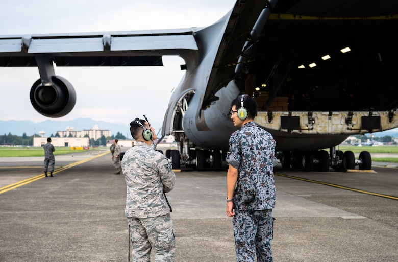 U.S. Air Force and Japan Air Self Defense Force Airmen talk about the C-5 Super Galaxy