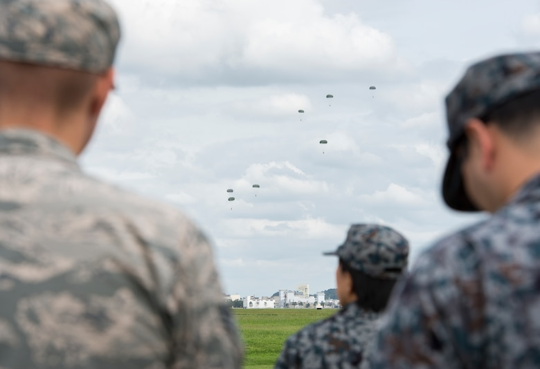 Members from the Bilateral Exchange Program watch as the U.S. Army 1st Special Forces Group performs a jump training