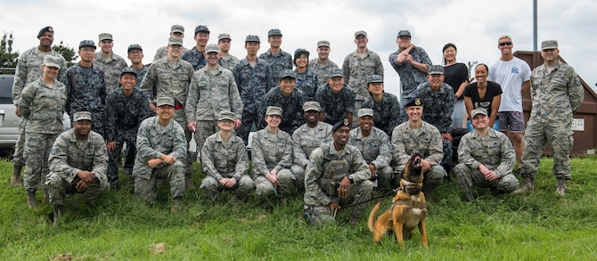U.S. Air Force and Japan Air Self-Defense Force members pose for a photo