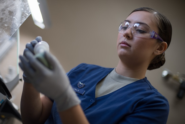 Staff Sgt. Kimberly Conklin, 2nd Dental Squadron dental laboratory NCO in-charge, works on making a retainer at Barksdale Air Force Base, La., Aug. 30, 2018. When dentists bring new impressions to the lab, technicians must stop what they are doing and immediately fill the impression before it can no longer be used. (U.S. Air Force photo by Senior Airman Stuart Bright)