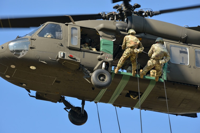 Soldiers conduct rappelling and ruck march during air assault course at the Grafenwoehr Training Area, Germany, Sept. 20-21, 2018.