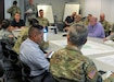 Soldiers and civilian employees of the U.S. Army Reserve's 99th Readiness Division meet in the division's Emergency Operations Cell to discuss Hurricane Florence Sept. 17 at division headquarters on Joint Base McGuire-Dix-Lakehurst, New Jersey. The 99th DIV(R) ran 24-hour operations in its EOC for several days during Florence's initial landfall and push inland, and was prepared to support relief efforts in several ways to include providing 13 U.S. Army Reserve facilities to shelter evacuees, readying equipment such power generators and water-purification systems, activating several public affairs teams to provide news coverage, and maintaining accountability of Soldiers throughout the affected areas.