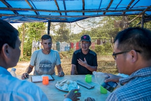 Translator talks with local people in Vietnam.
