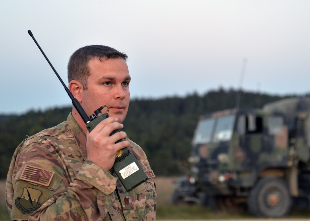 Maj. Jack Talkington, 4th Air Support Operations Group air mobility liaison officer, listens to radio during Saber Junction 18 in Germany, Sept. 20, 2018. As a liaison between the air and ground components, Talkington helped with the planning and development of operations of SJ18. (U.S. Air Force photo by Staff Sgt. Jimmie D. Pike)