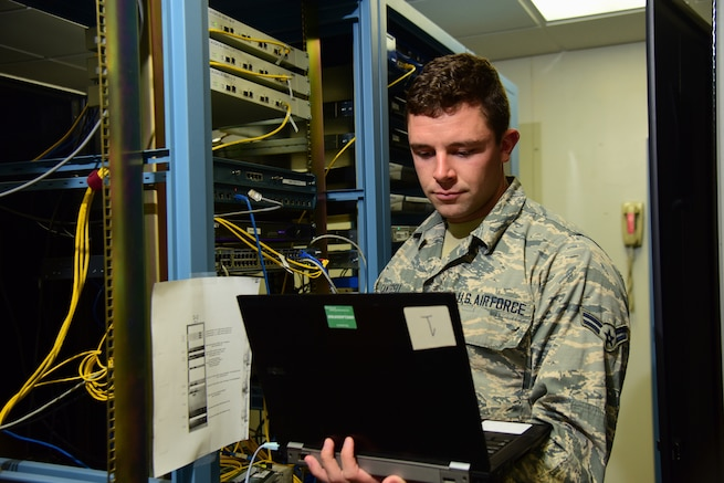 "Airman 1st Class Beau Cantrell, 47th Communications Squadron cyber transport technician, logs into a ""switch"" to check the configuration in a server room, Sept. 24, 2018, at Laughlin Air Force Base, Texas. With the Network-as-a-Service agreement, Airmen like Cantrell will be able to transition to core cyber missions, like cyber defense. (U.S. Air Force photo by Airman 1st Class Marco A. Gomez)"