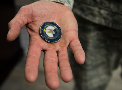Lt. Col. William Parker, 628th Force Support Squadron commander, holds his unit coin Aug. 30, 2018. Honoring someone with a commander's coin is a way for senior leadership to show their appreciation for a phenomenal job on the spot. It is more than just a thank you or a pat on the back, it is something tangible to remember the moment by.