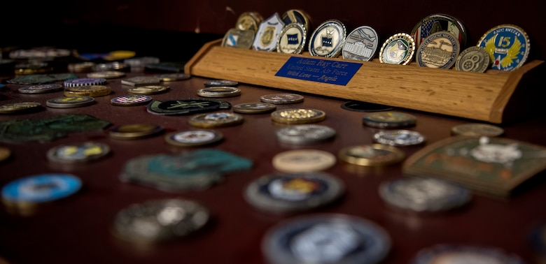 Senior Master Sgt. Adam Carr, 628th Comptroller Squadron wing staff agencies superintendent, displays his coin collection in his office at Joint Base Charleston, S.C. Many military members can remember a time when they got coined, whether it was the first coin they ever received or a coin they were awarded from a special moment.