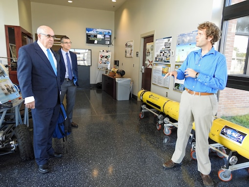 PANAMA CITY, Florida - Naval Surface Warfare Center Panama City Division (NSWC PCD) Autonomous Systems Engineer Dr. Matthew Bays discusses unmanned underwater vehicles, robotics, and autonomy with Virginia Polytechnic Institute and State University's Senior Advisor Capt. Jon Greene, USN Ret. (left) and Center for Marine Autonomy and Robotics Director Dr. Dan Stilwell (center), during a collaboration and recruiting visit at NSWC PCD Sept. 26, 2018. U.S. Navy photo by Susan H. Lawson