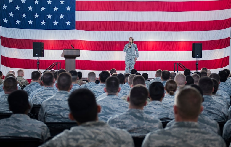 Col. Jennifer Short, 23d Wing commander, addresses Team Moody during a commander's call, Sept. 24, 2018, at Moody Air Force Base, Ga. Short used the opportunity to communicate directly with Team Moody Airmen, update them on local and national objectives and initiatives and highlight superior performers. (U.S. Air Force photo by Andrea Jenkins)