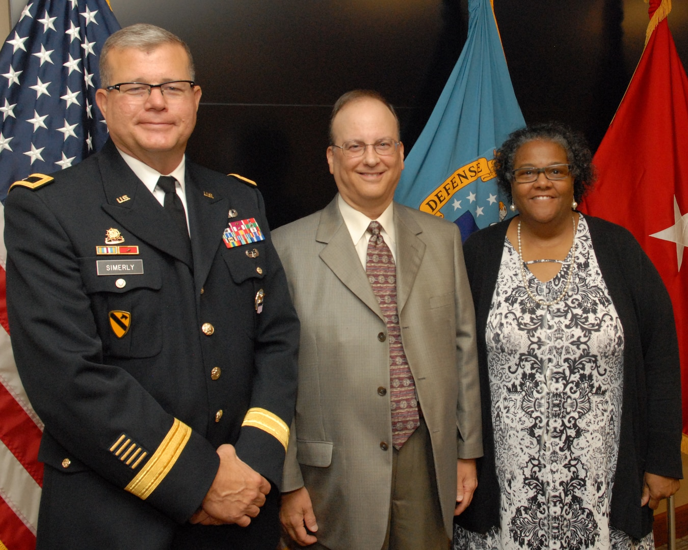 Anita Parker (right) and Philip DiBabbo (center) pose with DLA Troop Support Commander Army Brig. Gen. Mark Simerly (left) after being recognized for their service during a retirement ceremony Sept. 26 in Philadelphia.