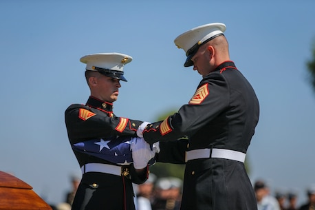 U.S. Marines with the Company F, 2nd Battalion, 7th Marine Regimant, 1st Marine Division, Color Guard, fold an American flag, during Pfc. Roger Gonzales' funeral service at the Green Hill Mortuary and Memorial Chaple, Rancho Palos Verdes, California, Sept. 21, 2018.