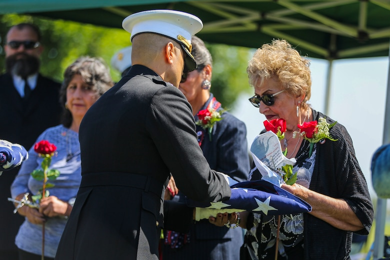 The family of Pfc. Roger Gonzales recive American flags during his funeral service at the Green Hill Mortuary and Memorial Chaple, Rancho Palos Verdes, California, Sept. 21, 2018.