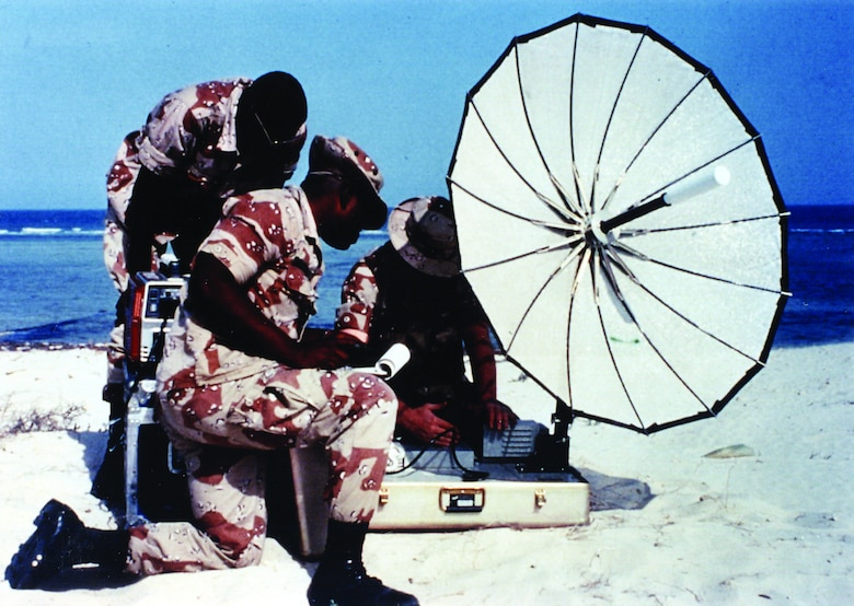 Airmen set up a mobile satellite communications system at Eskan Village, Saudi Arabia, in the early 1990s.