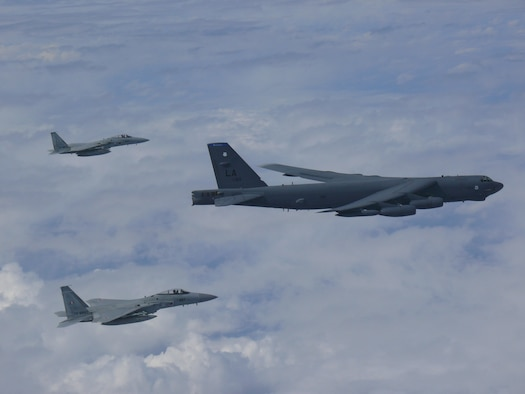 A U.S. Air Force B-52H Stratofortress bomber and two Koku Jieitai (Japan Air Self-Defense Force) F-15 fighters execute a routine bilateral training mission over the East China Sea and the Sea of Japan, Sept. 26, 2018.
