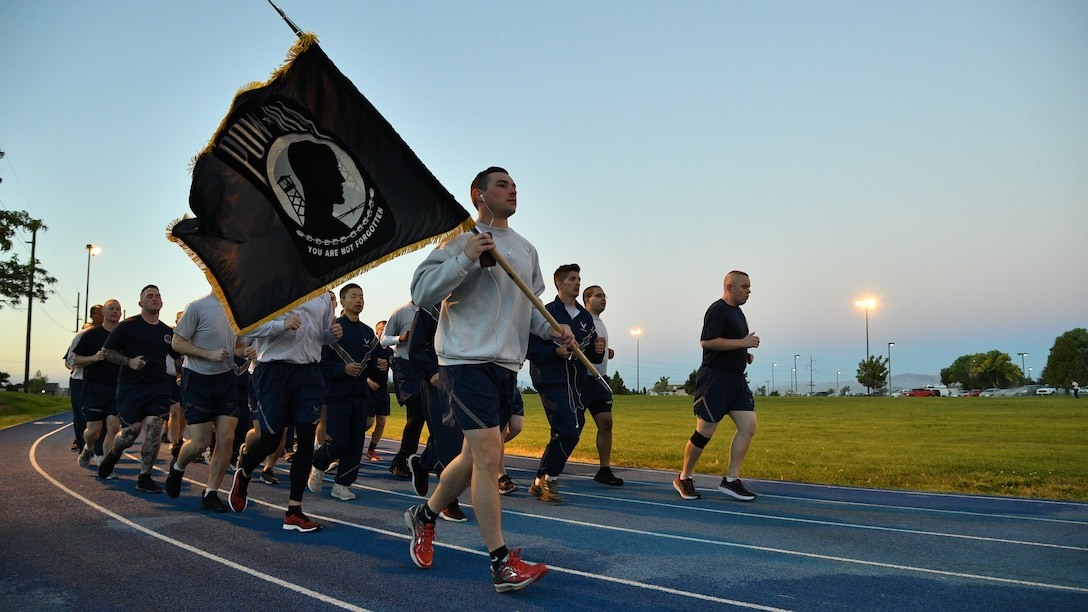 More than 200 Team Hill Airmen kept the POW/MIA flag in motion for 24 hours around the Warrior Fitness Center's outdoor track to commemorate POW/MIA Recognition Day Sept. 21.