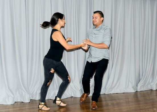 Dancers Andres Kabrera and Marci Herrera from the International Dance Fitness Academy perform at the Hispanic Heritage Observance Luncheon at Club Muroc on Edwards Air Force Base, California, Sept. 25. Gonzalez jokingly explained that using vapor rub to cure ailments is a Hispanic-American tradition. (U.S. Air Force photo by Giancarlo Casem)