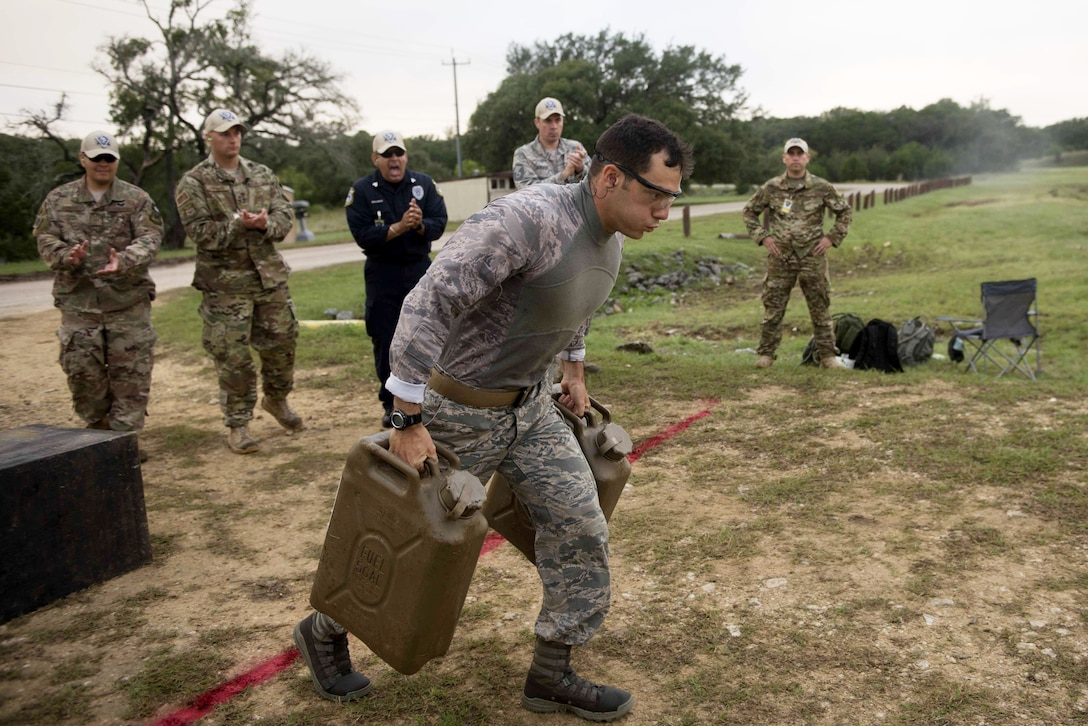 Senior Airman Joseph Pace, 92nd Security Forces Squadron installation patrolman, competes on the Air Mobility Command team during a combat endurance competition at the Air Force 2018 Defender Challenge in Joint Base San Antonio, Texas, Sept. 13, 2018. Fourteen Security Forces teams from Great Britain, Germany and U.S. Air Force major commands tested their skills in realistic weapons scenarios, simulated dismounted operations and grueling combat endurance events as part of the challenge. (U.S. Air Force photo/ Sarayuth Pinthong)