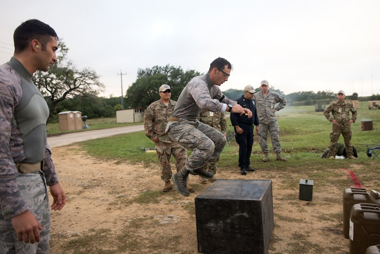 Senior Airman Joseph Pace, 92nd Security Forces Squadron installation patrolman, competes on the Air Mobility Command team during a combat endurance competition during Air Force 2018 Defender Challenge in Joint Base San Antonio, Texas, Sept. 13, 2018. Fourteen Security Forces teams from Great Britain, Germany and U.S. Air Force major commands test their skills in realistic weapons scenarios, simulated dismounted operations and grueling combat endurance events as part of Air Force Defender Challenge. The team with the most combined points wins the coveted Defender Challenge Championship Trophy. (U.S. Air Force photo/ Sarayuth Pinthong)