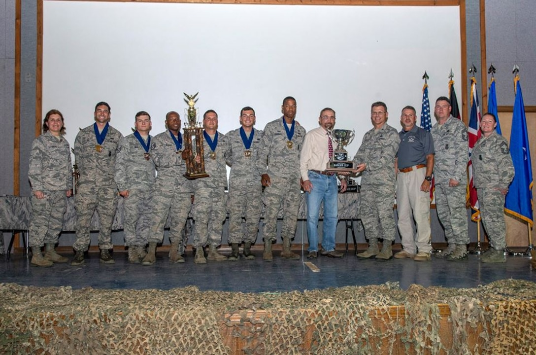 The Air Mobility Command team receives the Sadler Cup for best final score in dismounted operations during the 2018 Defender Challenge award ceremony at Joint Base San Antonio, Texas, Sept. 13, 2018.  The objective of the challenge was to measure strength, endurance, agility, teamwork, leadership, problem-solving and knowledge of core skills. (Courtesy Photo)