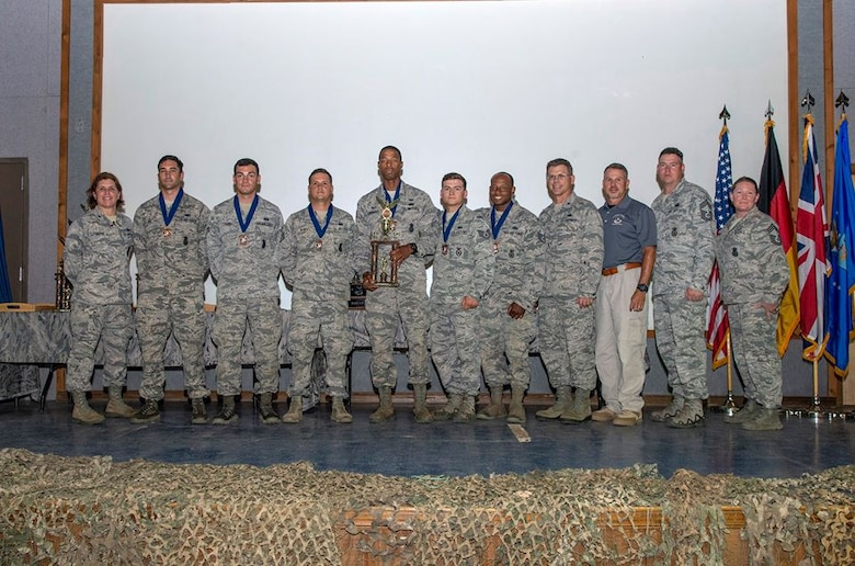 The Air Mobility Command team receives the 3rd place medals and trophy for combat endurance during the 2018 Defender Challenge award ceremony at Joint Base San Antonio, Texas, Sept. 13, 2018. Teams were scored on their completion of a gruelling relay of calisthenics to increase their physiological stress level prior to firing at a target with their weapon. (Courtesy Photo)