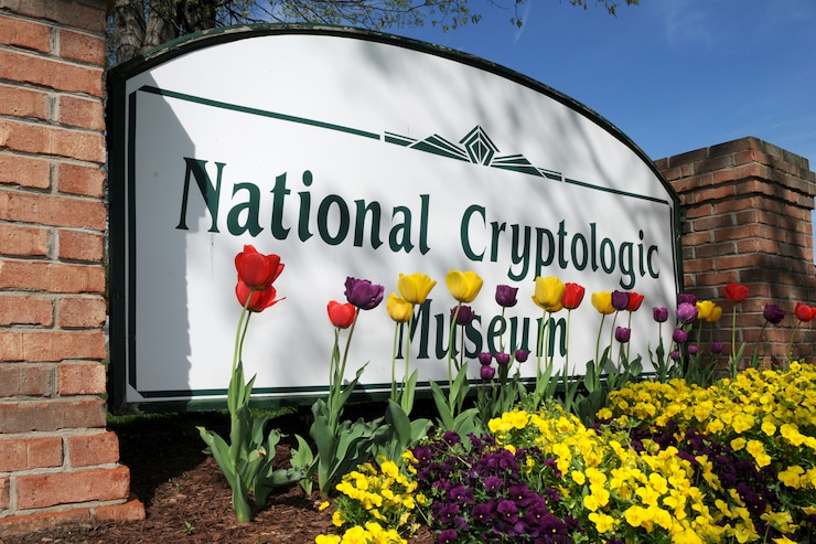 National Cryptologic Museum Sign with spring flowers in front of it.