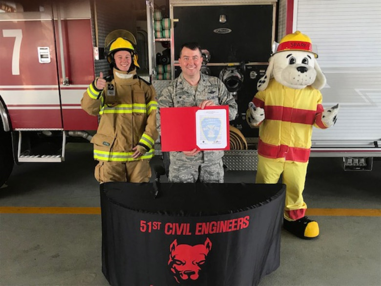 Col. William Betts, 51st Fighter Wing commander, signs the annual Fire Prevention Week proclamation on Osan Air Base, Republic of Korea, Sept. 27, 2018.