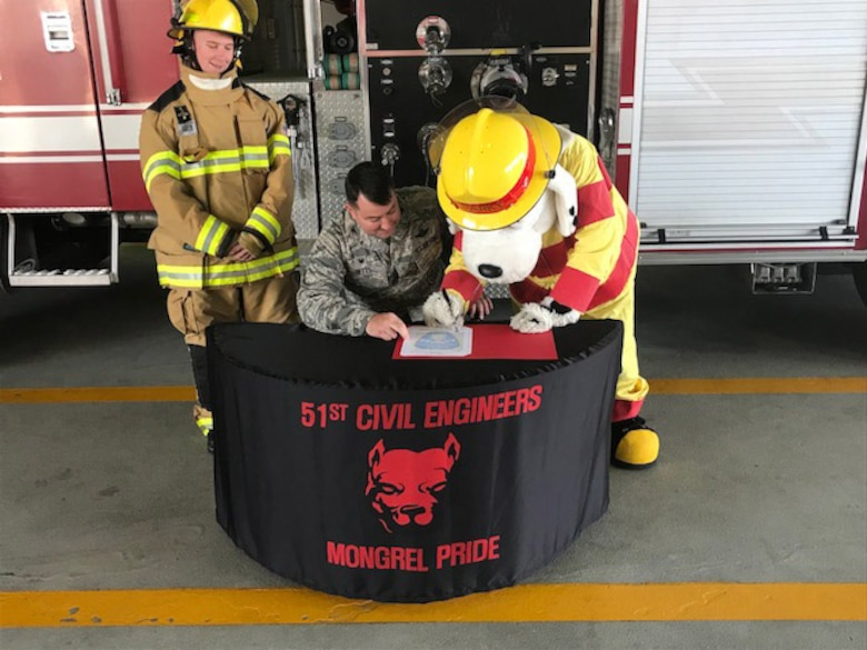 Col. William Betts, 51st Fighter Wing commander, signs the annual Fire Prevention Week proclamation on Osan Air Base, Republic of Korea, Sept. 27, 2018. Fire Prevention Week, which begins Oct. 7, will focus on increasing awareness and educating Airmen and their families about risks, safe habits, and what to do in a fire emergency. (U.S. Air Force courtesy photo)