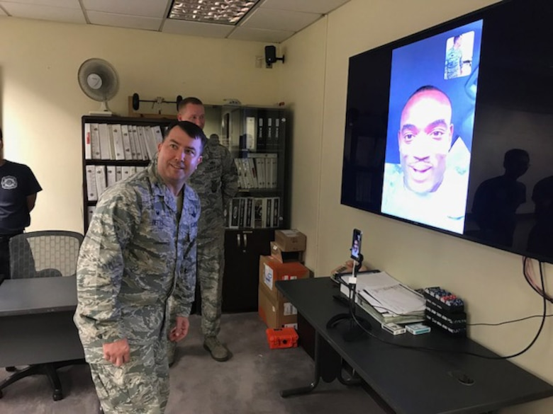 Col. William Betts, 51st Fighter Wing commander, speaks to Staff Sgt., Gregory Francois, formerly of the 51st Civil Engineer Squadron, and promotes him to the rank of technical sergeant through the Air Force's STEP (Stripes for Exceptional Performers) program via FaceTime from Osan Air Base, Republic of Korea, Sept. 27, 2018.