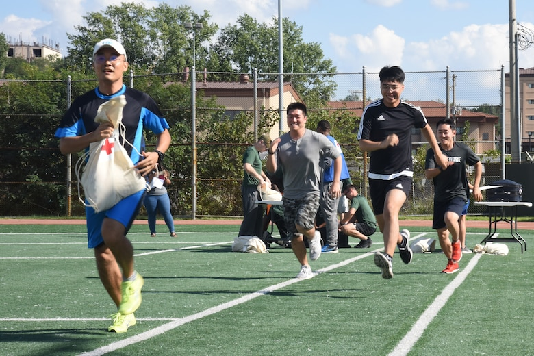 Republic of Korea Air Force personnel run to the next station during the Mustang Challenge relay at Osan Air Base, Republic of Korea, Sept. 27, 2018. The relay was held in recognition of National Preparedness Month, which is recognized in the U.S. to highlight the importance of always being prepared before a disaster. (U.S. Air Force photo by Tech. Sgt. Ashley Tyler)