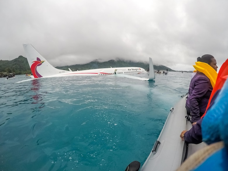 CHUUK, Federated States of Micronesia (Sept. 28, 2018) U.S. Navy Sailors from Underwater Construction Team (UCT) 2 assist local authorities in shuttling the passengers and crew of Air Niugini flight PX56 to shore following the plane crashing into the sea on its approach to Chuuk International Airport in the Federated States of Micronesia.