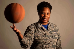 Air Force 1st Lt. Brittnie Davis, Air Mobility Command intelligence officer, shares how hard work and determination helped her achieve her goals of playing basketball and becoming an officer. Air Force photo by Airman 1st Class Tara Stetler