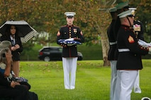 Corporal Justin M. Perry, flag bearer, Marine Barracks Washington D.C., holds the National Flag during a full honors funeral for three formerly unaccounted for Vietnam veterans at Arlington National Cemetery, Arlington, Va., Sept. 27, 2018.