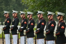 Marines with the Bravo Company firing party, Marine Barracks Washington D.C., stand at a ceremonial position during a full honors funeral for three formerly unaccounted for Vietnam veterans at Arlington National Cemetery, Arlington, Va., Sept. 27, 2018.