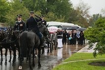 Marine Corps Body Bearers, Bravo Company, Marine Barracks Washington D.C., carry a casket during a full honors funeral for three formerly unaccounted for Vietnam veterans at Arlington National Cemetery, Arlington, Va., Sept. 27, 2018.