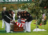 Marine Corps Body Bearers, Bravo Company, Marine Barracks Washington D.C., prepare to fold the National Flag during a full honors funeral for three formerly unaccounted for Vietnam veterans at Arlington National Cemetery, Arlington, Va., Sept. 27, 2018.