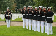 Marines with the Bravo Company firing party, Marine Barracks Washington D.C., render a three-volley salute during a full honors funeral for three formerly unaccounted for Vietnam veterans at Arlington National Cemetery, Arlington, Va., Sept. 27, 2018.