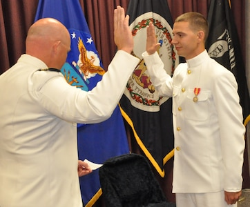 IMAGE: DAHLGREN, Va. (Sept. 21, 2018) – U.S. Navy Capt. Andrew Thomson administers the oath of office to Dillard Patton during Patton's Naval officer commissioning ceremony at the Aegis Training and Readiness Center. Once the NSWC Dahlgren Division System Safety Engineering Division civilian engineer pledged the oath of office, he was commissioned into the officer ranks of the Naval Reserves.