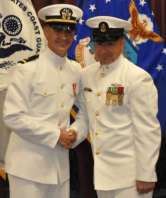 IMAGE: DAHLGREN, Va. (Sept. 11, 2018) – Senior Chief Fire Controlman Jeremy Brown (ret.) and U.S. Navy Ensign Dillard Patton moments after Brown rendered the first enlisted salute to Patton who then returned the salute at his commissioning ceremony held at the Aegis Training and Readiness Center. In accordance with tradition, Patton - an NSWCDD System Safety Engineering Division civilian engineer - presented a brand new silver dollar to Brown as the first enlisted service member who saluted him.