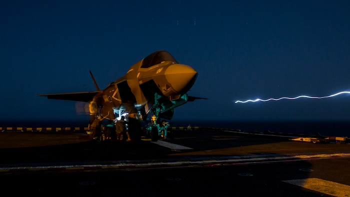 U.S. Marines with Marine Fighter Attack Squadron 211, 13th Marine Expeditionary Unit, load ordnance into an F-35B Lightning II aboard the Wasp-class amphibious assault ship USS Essex in preparation for the F-35B's first combat strike, Sept. 27, 2018.