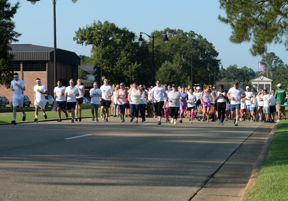 Participants begin the sixth annual Color Run Sept. 22, 2018, at Columbus Air Force Base, Mississippi. The event consisted of a 5K run or a 2-mile run that participants could choose from. (U.S. Air Force photo by Airman Hannah Bean)