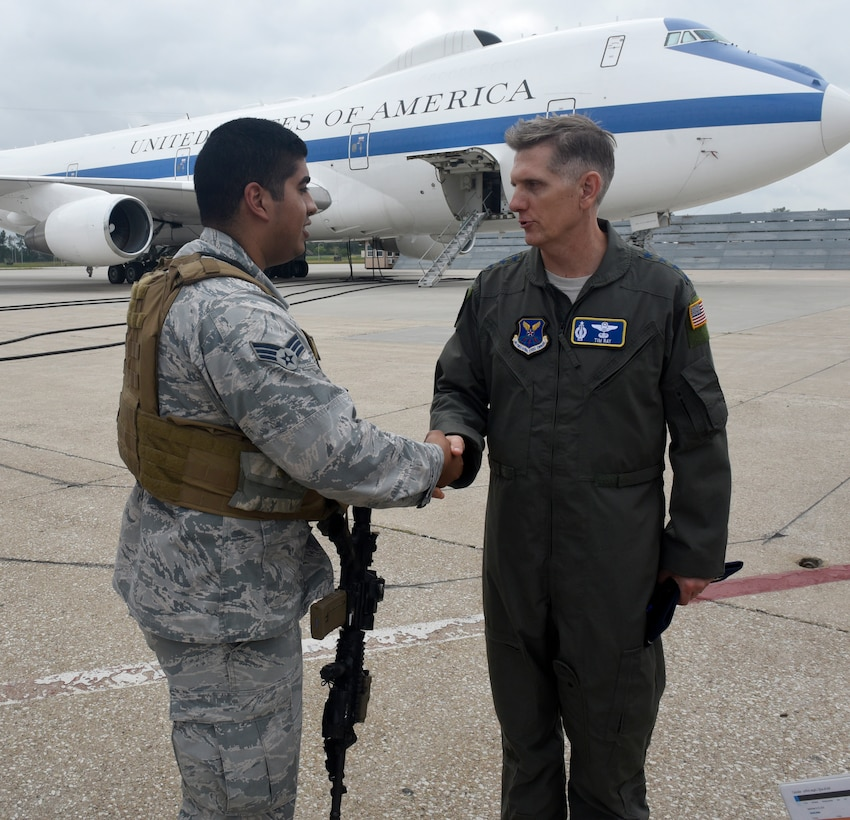 U.S. Air Force Gen. Timothy Ray, Air Force Global Strike Command commander (right), shakes the hand of Senior Airman Ricardo Gonzalez, 55th Wing Security Forces Squadron, at an E-4B aircraft entry-control point Sept. 13, 2018 at Offutt Air Force Base, Nebraska. During his visit, the general met with the men and women who ensure a 24/7/365 direct connection between the president of the United States and all nuclear forces under his authority (U.S. Air Force photo by Drew Nystrom)