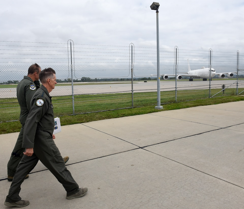 U.S. Air Force Gen. Timothy Ray, Air Force Global Strike Command commander walks the flightline as a U.S. Navy E-6B aircraft, with a crew which includes members of the 625th Strategic Operations Squadron, taxis at Offutt Air Force Base, Nebraska Sept. 13, 2018. The 625 STOS mission is unique to the ICBM community in that it provides the commander of United States Strategic Command with a secondary Minuteman III launch capability through the Airborne Launch Control System. Housed aboard the Navy's E-6B aircraft, the ALCS serves as a vital backup to Minuteman launch control centers. (U.S. Air Force photo by Drew Nystrom)