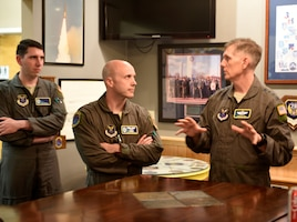 U.S. Air Force Gen. Timothy Ray, Air Force Global Strike Command commander, addresses a point made by U.S. Air Force Capt. Jared Fairchild, a 625th Strategic Operations Squadron Airborne Launch Control System officer, during a discussion at Offutt Air Force Base, Nebraska Sept. 13, 2018. The 625 STOS mission is unique to the ICBM community in that it provides the commander of United States Strategic Command with a secondary Minuteman III launch capability through the Airborne Launch Control System. Housed aboard the Navy's E-6B aircraft, the ALCS serves as a vital backup to Minuteman launch control centers. (U.S. Air Force photo by Drew Nystrom)